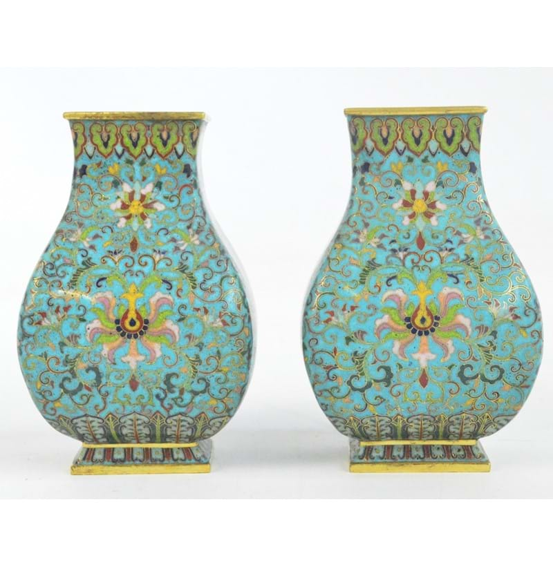 A pair of 19th century Chinese cloisonné enamel decorated brass vases of rectangular baluster form.