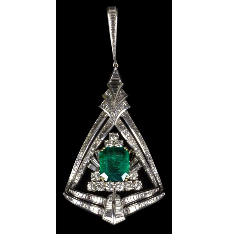 A large and impressive 18ct white gold diamond and emerald pendant.