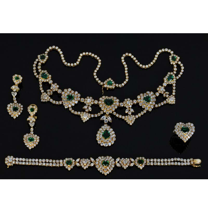 An impressive 18ct yellow gold diamond and emerald suite of jewellery.
