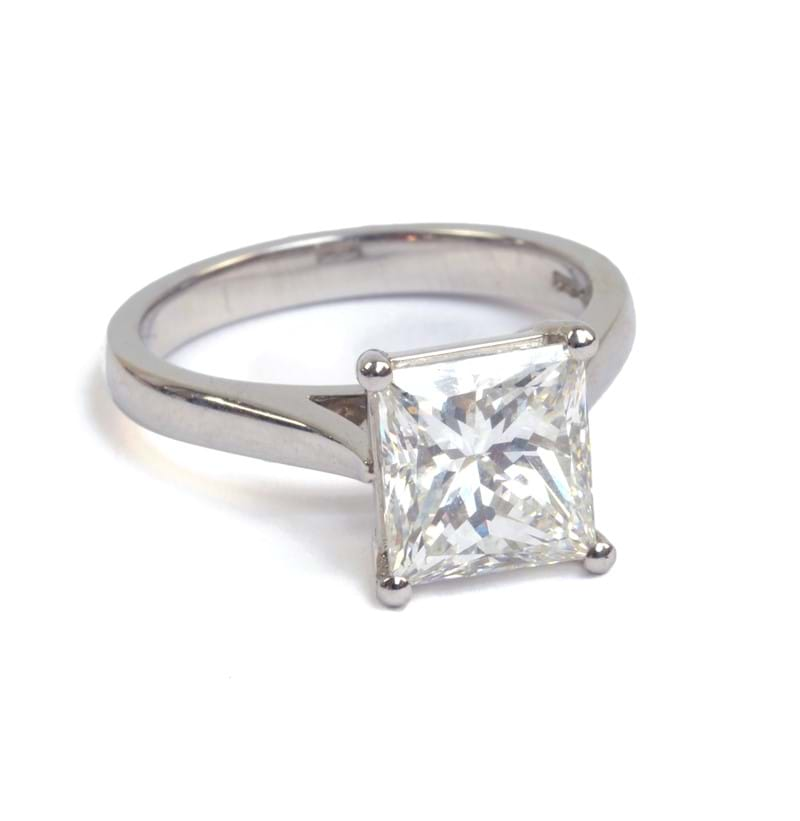 An impressive platinum diamond and solitaire ring.