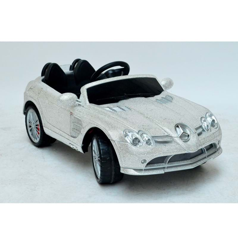 A unique child's Mercedes SLR 7225 toy car set with Swarovski crystals.