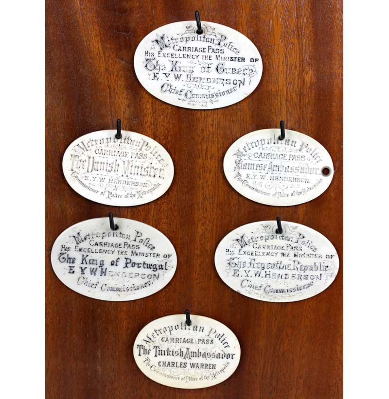 An unusual group of six 19th century ivory carriage pass tokens.
