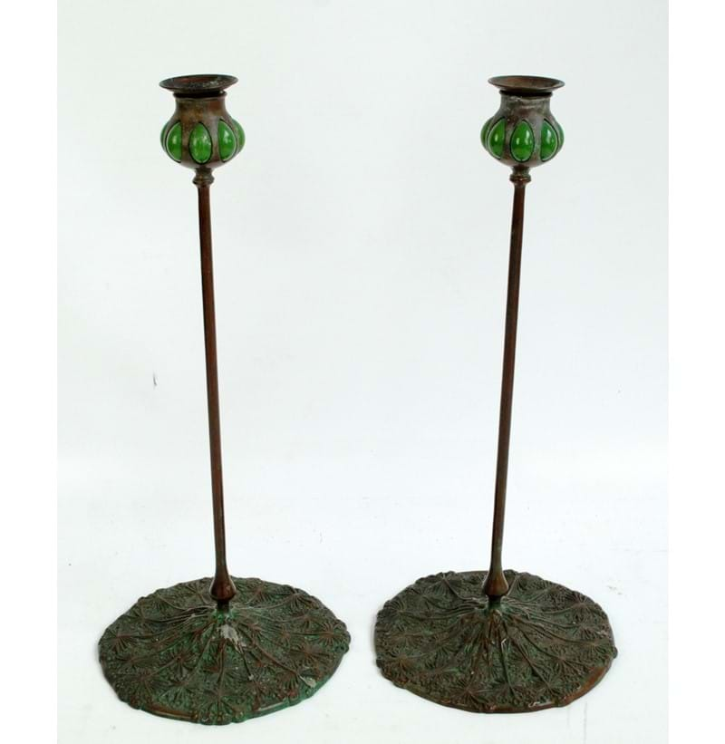 TIFFANY STUDIOS, NEW YORK (1899-1918); a pair of patinated bronze and Favrile glass tall candlesticks.