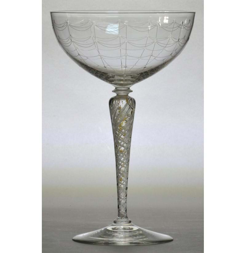 JAMES POWELL WHITEFRIARS; a pedestal shallow bowl with spiders web etched decoration by Hillebauer.