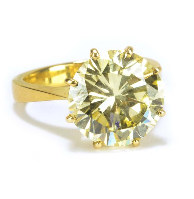 An impressive 18ct yellow gold and fancy light yellow brilliant cut diamond solitaire ring.